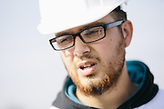 "Nicolas Rangel, 20, helped his mom, Maria Zavala, build her home in a self-help community in Madera, California. Now, he is helping the Grid Alternatives team put solar panels on the roof of her home. Rangel is at a crossroads in his life and has been contemplating joining the military. But, since volunteering for the Solarthon event in the neighborhood, he sees a different career opportunity in solar. ""Hopefully this whole two weeks (volunteering at Solarthon) is a road that paved itself and it's now asking me to walk it. If I have to take classes, I will,"" he said."