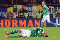 ROMANIA, Bucharest : Northern Ireland's Kyle Lafferty is injured  during the Euro 2016 Group F qualifying football match Romania vs Northern Ireland in Bucharest, Romania on November 14, 2014.
