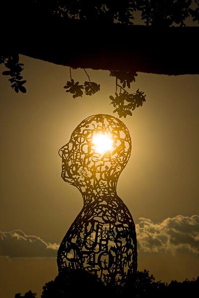 Stock photo of Artist Jaume Plensa's Tolerance sculptures on Allen Parkway in Houston Texas at sunset
