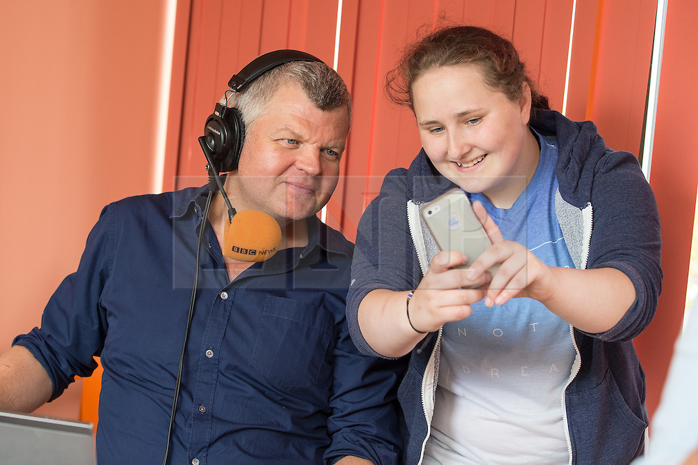 © Licensed to London News Pictures . 11/08/2015 . Merseyside , UK . ADRIAN CHILES posing for selfie with young carer JAMIE (15) . BBC Radio 5 Live broadcast live from Clock View mental health Hospital in Merseyside . Photo credit : Joel Goodman/LNP
