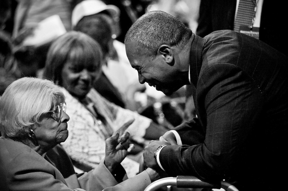 Governor Deval Patrick listens to a constituent's advice before addressing the crowd at the 2012 Democratic State Convention at Lowell's Mass Mutual Center.