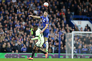 Gary Cahill of Chelsea jumps up over Kelechi Iheanacho of Manchester City to head the ball. The Emirates FA Cup, 5th round match, Chelsea v Manchester city at Stamford Bridge in London on Sunday 21st Feb 2016.<br /> pic by John Patrick Fletcher, Andrew Orchard sports photography.