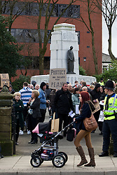 © licensed to London News Pictures. Heywood, UK  03/03/2012. The National Front hold a demonstration in Heywood, Greater Manchester. They protested against an alleged paedophile ring that had been operating in the area. There is currently a case being tried at Liverpool Crown Court in relation to the allegations. Last Thursday (23rd February) a protest organised in the town in relation to the same story resulted in Asian business being attacked by an angry mob. Photo credit should read Joel Goodman/LNP