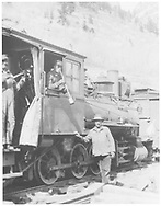"""RGS class 60 locomotive at Telluride with Engineer Walter Virden playing oil can and Fireman Winfield Laube with a banjo shovel while a workman stands alongside the engine.<br /> RGS  Telluride, CO  ca. 1915<br /> In book """"Rio Grande Southern, The: An Ultimate Pictorial Study"""" page 86<br /> Same image as RDS063-049.<br /> Thanks to Don Bergman for additional information."""
