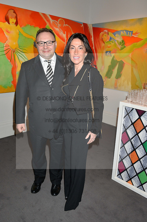 JONATHAN & KATRINA SHALIT at a private view of Made in Britain featuring contents from The Ivy sold to benefit Child Bereavement UK held at Sotheby's, 34-35 New Bond Street, London on 23rd March 2015.