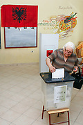 A woman cast a ballot at a polling station in Tirana, Albania on Sunday, Jun 28, 2009. Albanians are voting to elect the 140 members of the Albanian Parliament. The EU will closely watch the entire elections process, they said, stressing that 'international and European standards' must be met by Albania, which formally applied for EU membership in April, but has not moved forward since. (Photo by Vudi Xhymshiti)