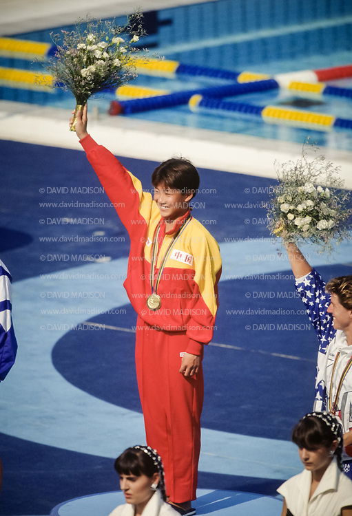 BARCELONA - JULY 27:  Fu Mingxia of China receives her Olympic gold medal in Women's 10 meter Diving  at the Piscina Municipal de Montjuic on July 27, 1992 during the Summer Olympics in Barcelona, Spain.  (Photo by David Madison/Getty Images)