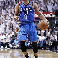 21 June 2012: Oklahoma City Thunder point guard Russell Westbrook (0) brings the ball upcourt during the Miami Heat 121-106 victory over the Oklahoma City Thunder, in Game 5 of the 2012 NBA Finals, at the AmericanAirlinesArena, Miami, Florida, USA. The Miami Heat wins the series 4-1.