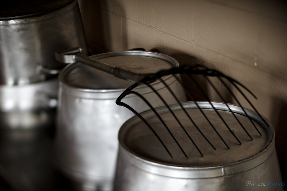 """A giant fork is used to remove the pork from the pots after cooking. Mack's Liver Mush & Meats at his facilities. Liver mush processors Jenkins Foods and Mack's Liver Mush & Meats make pork liver mush that is known for its high quality in the rural countryside just outside the city  limits of Shelby, NC. The two companies, located about a mile from each, create 34,000 and 40,000 pounds of liver mush every week. Liver mush is a ground mixture of pork liver, corn meal and spices. It sometimes contains other pieces of the hog's head to provide flavor and texture. It is traditionally packed into a loaf pan, chilled and sliced before serving. The food got its start in the Depression-era and is  considered """"Southern weird"""" by some and a kitchen staple by others. Documented on Monday, December 8, 2014, in Shelby, N.C."""