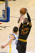 Cleveland Cavaliers guard Kyrie Irving (2) shoots a jumper over Golden State Warriors guard Klay Thompson (11) during Game 5 of the NBA Finals at Oracle Arena in Oakland, Calif., on June 12, 2017. (Stan Olszewski/Special to S.F. Examiner)