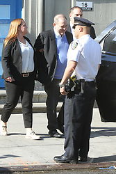 A New York police man stands guard as the media awaits Harvey Weinstein's exit at the1st Precinct as he is to be officially charged with rape today in New York City. 25 May 2018 Pictured: Harvey Weinstein. Photo credit: RW/MPI/Capital Pictures / MEGA TheMegaAgency.com +1 888 505 6342