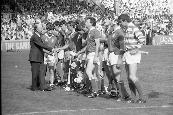 All Ireland Hurling Finals.1986..07.09.1986..09.07.1986..7th September 1986..September,every year,is the highlight of the GAA calendar with The All Ireland Finals being held in both codes. The senior and minor finals in each code are both played for on the same day. Each finalist has battled through provinical and knock out stages to reach the final.It is widely regarded as the pinnacle of a players career to reach and win an All Ireland Championship..In this years hurling finals,Cork played Offaly in the minor championship and a much fancied Galway team took on Cork in the senior final. Both matches were well fought and close encounters...In the senior hurling final Cork emerged victorious with a score of 4.13 (25) to Galways' 2.15 (21). .Photograph of the Cork senior hurling team being introduced to The President of Ireland Dr Patrick Hillery, by Cork captain,Liam Cashman..