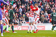Tommy Rowe of Doncaster Rovers (10) scores a goal and celebrates with team mates to make the score 1-0 during the EFL Sky Bet League 1 match between Doncaster Rovers and Plymouth Argyle at the Keepmoat Stadium, Doncaster, England on 13 April 2019.
