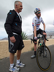 © London News Pictures. File picture dated 19/05/2012. Olympic gold medal cyclist Bradley Wiggins (right) with his head coach Shane Sutton (left) while training in Tenerife, Spain in May 2012. Shane Sutton has been injured in a cycling accident just hours after Bradley Wiggins  was involved in a collision with a van while on his bike. Photo credit: Ben Cawthra/LNP