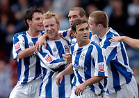 Photo: Glyn Thomas.<br />Huddersfield Town v Welling United. The FA Cup. 06/11/2005.<br />Huddersfield's Andrew Booth is mobbed by teammates after giving his side a 1-0 lead.