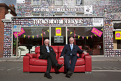 "© licensed to London News Pictures. London, UK 06/08/2012. Maurice (L) and Trevor Reeves, the owners of the House of Reeves furniture store which was burnt down in last year's riots, posing outside their shop. The shop has been covered in 4000 images of young people with positive messages on August 6, 2012 in Croydon. The youth volunteering charity ""vInspired"" are marking the one year anniversary of the riots in Croydon by displaying thousands of images of young Britons holding up positive messages about themselves on the House of Reeves furniture store which was destroyed in last year's violence. Photo credit: Tolga Akmen/LNP"
