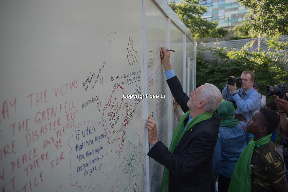 Jeremy Corbyn writing a massages at the Grenfell Silent Walk - 1 Year On to mark the anniversary of the Grenfell Tower fire, demand Justice for Grenfell on June 14, 2018, London, UK.