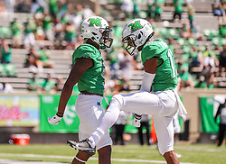 Sep 5, 2020; Huntington, West Virginia, USA; Marshall Thundering Herd wide receiver Talik Keaton (9) catch a touchdown and celebrates with Marshall Thundering Herd wide receiver Broc Thompson (13) during the first quarter against the Eastern Kentucky Colonels at Joan C. Edwards Stadium. Mandatory Credit: Ben Queen-USA TODAY Sports