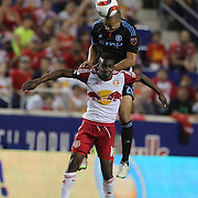 Jason Hernandez, NYCFC, wins a header from Lloyd Sam, New York Red Bulls, during the New York Red Bulls Vs NYCFC, MLS regular season match at Red Bull Arena, Harrison, New Jersey. USA. 10th May 2015. Photo Tim Clayton