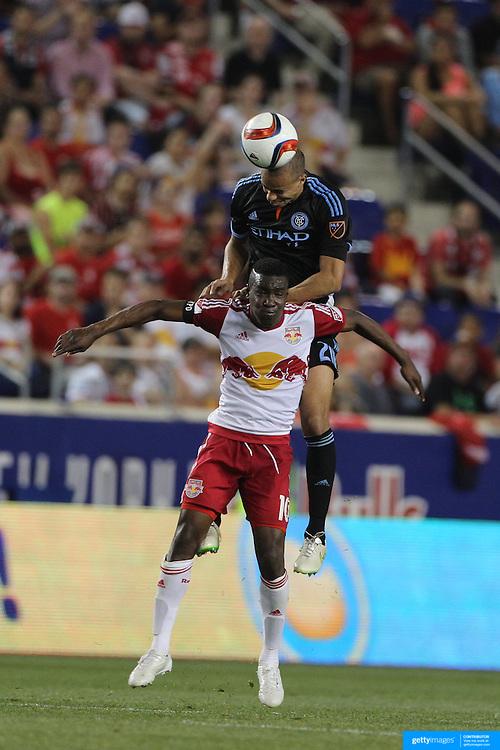 Jason Hernandez, NYCFC, wins a header from Lloyd Sam, New York Red Bulls, during the New York Red Bulls Vs NYCFC, MLS regular season match at Red Bull Arena, Harrison, New Jersey. USA. 10th May 2015. Photo Tim Clayton