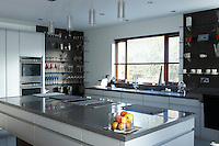 kitchen with central food preparation area in modern house