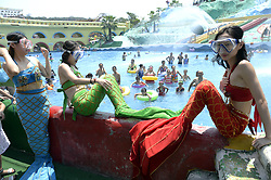 August 21, 2017 - Chongqin, China - Women wearing mermaid costumes enjoy the cool at the swimming pool in southwest China's Chongqing. (Credit Image: © SIPA Asia via ZUMA Wire)
