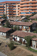 Roma gypsies living in the 'Baraki' area - named after the barracks which were built many years ago after a landslide. The Roma still live there, whilst their neighbourhood is surrounded by modern housing developments containing non-Roma population. They call this modern housing 'Orange County'. In Veliko Turnovo, Bulgaria..Roma Gypsies left India 1000 years ago. Often nomadic. A collection of tribes with their own languages and culture, pushed by the Ottoman empire towards Europe, used and sold as mercenaries, slaves, prostitutes. They endured 500 years of slavery until mid 19th century. A million were killed in the holocaust. Hundreds of thousands exiled and refugees from kosovo. Many Eastern Europe Roma come to the west seeking a better life. They are shunned, marginalized, excluded. Both indigenous and foriegn Roma, whether European citizens or not, lack the opportunities of others, living on the periphery, in the brunt of racism, often deported back to their countries of origin.