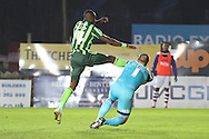 Bobby Olejnik (goalkeeper) of Exeter City gets to the ball before the imposing Ade Azeez of AFC Wimbledon during the Sky Bet League 2 match between Exeter City and AFC Wimbledon at St James' Park, Exeter, England on 28 December 2015. Photo by Stuart Butcher.