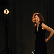 Director Geneieve Aichele steps in front of a spot light during setup before the show begins.