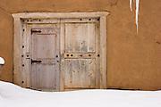 Historic building door in winter, Taos, New Mexico