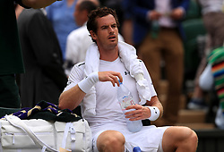 Andy Murray with an ice towel during his match against Benoit Paire on day seven of the Wimbledon Championships at The All England Lawn Tennis and Croquet Club, Wimbledon.