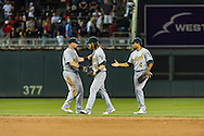 Oakland Athletics outfielders Jonny Gomes, Josh Reddick, and Coco Crisp celebrate after the Athletics defeated the Minnesota Twins on July 13, 2012 at Target Field in Minneapolis, Minnesota.  The Athletics defeated the Twins 6 to 3.  © 2012 Ben Krause