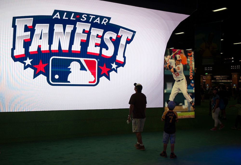 Fans check out the big curved screen as one of the entrances to the 2016 MLB All-Star FanFest at the San Diego Convention Center on Friday.<br /> <br /> ///ADDITIONAL INFO:   <br /> <br /> Fanfest.0709.kjs  ---  Photo by KEVIN SULLIVAN / Orange County Register  -- 7/8/16<br /> <br /> The 2016 MLB All-Star game Fan Fest at Petco Park and the San Diego Convention Center.