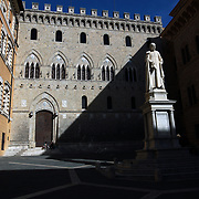 SIENA, ITALY - OCTOBER 28: The Palazzo Salimbeni in Siena, Italy. Siena is a city in central Italy's Tuscany region, is distinguished by its medieval brick buildings. The fan-shaped central square, Piazza del Campo, is the site of the Palazzo Pubblico, the Gothic town hall, and Torre del Mangia, a slender 14th-century tower with sweeping views from its distinctive white crown. Siena, Italy. 28th October 2017. Photo by Tim Clayton/Corbis via Getty Images)