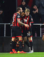 Callum Wilson (13) of AFC Bournemouth celebrates with Steve Cook (3) of AFC Bournemouth and David Brooks (20) of AFC Bournemouth after scoring the opening goal to make the score 1-0 during the Premier League match between Bournemouth and West Ham United at the Vitality Stadium, Bournemouth, England on 19 January 2019.