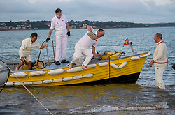 © Licensed to London News Pictures. 24/08/2017. Solent, UK. A group of crickets jump out of their boat ahead of the match. Teams take part in the Brambles Bank Cricket Match in the middle of The Solent strait on August 24, 2017. The annual cricket match between the Royal Southern Yacht Club and The Island Sailing Club, takes place on a sandbank which appears for 30 minutes at lowest tide. The game lasts until the tide returns. Photo credit: Ben Cawthra/LNP