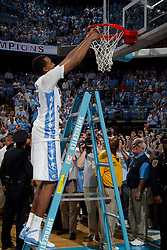 CHAPEL HILL, NC - MARCH 05: John Henson #31 of the North Carolina Tar Heels cuts down the net after defeating the Duke Blue Devils and winning the regular season ACC championship on March 05, 2011 at the Dean E. Smith Center in Chapel Hill, North Carolina. North Carolina won 67-81. (Photo by Peyton Williams/UNC/Getty Images) *** Local Caption *** John Henson