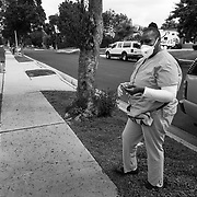 Home health care aide makes her way into a home to tend to an elderly resident. The mask and gloves are to guard against spread of the Coronavirus.