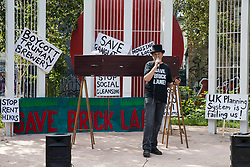 Jonathan Moberly of the Save Brick Lane campaign group and co-chair of the East End Preservation Society addresses local residents and supporters in Altab Ali Park before a funeral procession along Brick Lane in protest against the ongoing gentrification of Shoreditch on 12th September 2021 in London, United Kingdom. Campaigners are protesting in particular against plans to develop the Truman Brewery into a shopping centre and 5-storey office building. Tower Hamlets experienced more gentrification than any other London borough between 2010-2016.
