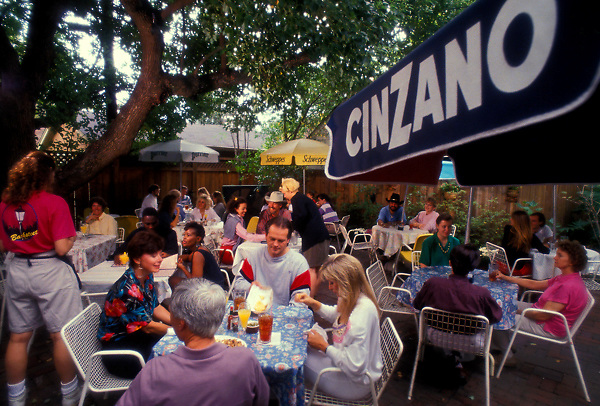 Stock photo of a back patio full of diners at a local Houston restauraant