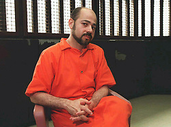 (FILES): File photo shows Mussa Mohammed Abu Marzuk in a prison interview room, 11 April, at the Metropolitan Correctional Center in New York. Jordan's King Hussein has decided to grant refuge to Abu Marzuk, political leader of the Palestinian milmitant group HAMAS, after convincing Washington to free him, a senior official said 30 April.