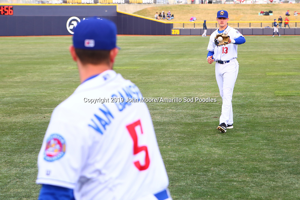 Amarillo Sod Poodles infielder Chris Baker (13) and infielder Peter Van Gansen (5) warm up before the game against the Corpus Christi Hooks on Saturday, April 13, 2019, at HODGETOWN in Amarillo, Texas. [Photo by John Moore/Amarillo Sod Poodles]