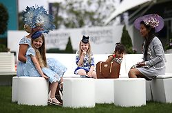 Female racegoers during ladies day of the 2018 Investec Derby Festival at Epsom Downs Racecourse, Epsom.