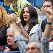 2019 US Open Tennis Tournament- Day Thirteen.    Meghan Markle, Duchess of Sussex reacts to a point while in the team box Serena Williams of the United States during the Women's Singles Final on Arthur Ashe Stadium during the 2019 US Open Tennis Tournament at the USTA Billie Jean King National Tennis Center on September 7th, 2019 in Flushing, Queens, New York City.  (Photo by Tim Clayton/Corbis via Getty Images)