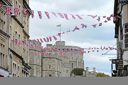 © Licensed to London News Pictures. 11/05/2018. WINDSOR, UK.  Union Jack bunting has been hung overhead as preparations continue in Windsor for the upcoming wedding between Prince Harry and Meghan Markle on 19 May.  Thousands of people are expected to visit the town for what has been billed as the wedding of the year.  Photo credit: Stephen Chung/LNP