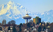 The Olympic Mountains loom behind the Space Needle in this telephoto view from Clyde Hill on the east side of Lake Washington. <br /> Mike Siegel / The Seattle Times