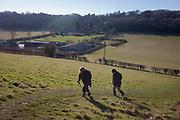 Friends in a community walking group enjoy winter sunshine, on 25th February 2018, near Cudham, Kent, England.