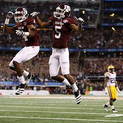 Jan 7, 2011; Arlington, TX, USA; Texas A&M Aggies wide receiver Kenric McNeal (5) celebrates with teammate wide receiver Brandal Jackson (4) following a touchdown against the LSU Tigers during the fourth quarter of the 2011 Cotton Bowl at Cowboys Stadium.  Mandatory Credit: Derick E. Hingle