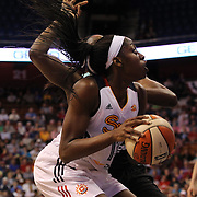 Chiney Ogwumike, Connecticut Sun, the WNBA number one draft pick making her WNBA debut, pump fakes and draws the foul as she is hit hard by Tina Charles, New York Liberty, the former Sun player during the Connecticut Sun Vs New York Liberty WNBA regular season game at Mohegan Sun Arena, Uncasville, Connecticut, USA. 16th May 2014. Photo Tim Clayton