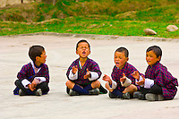 School children in native costume outside with teacher, Bumthang Valley, Bhutan
